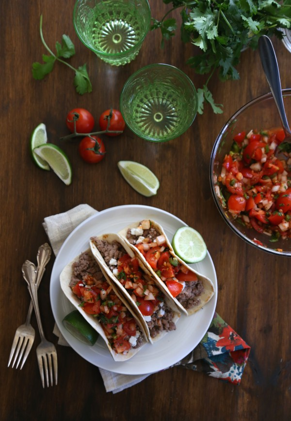spicy lamb tacos with harissa pico de gallo three