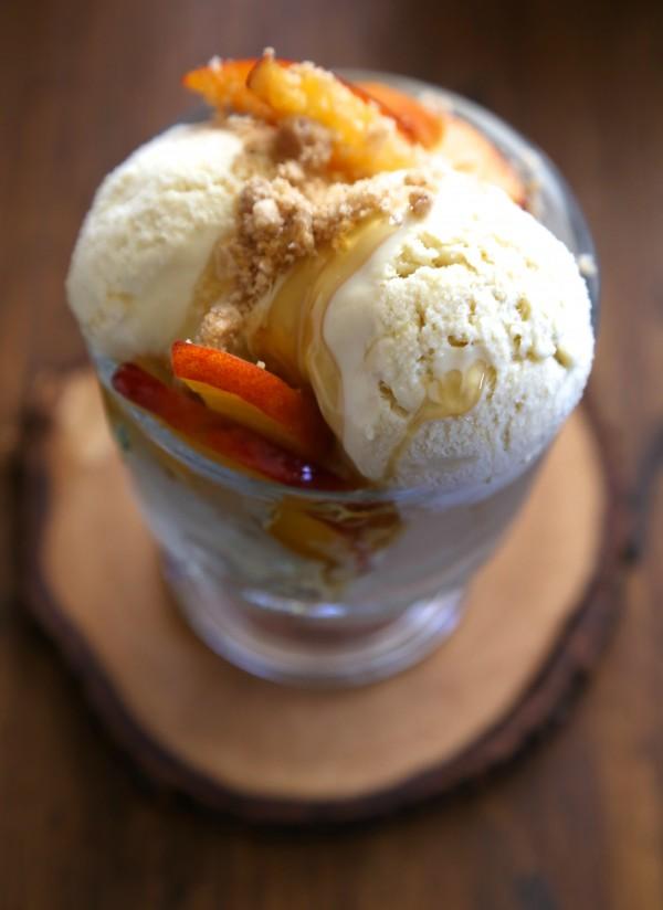 bourbon honey ice cream with brown butter crumble & fresh peaches www.climbinggriermountain.com