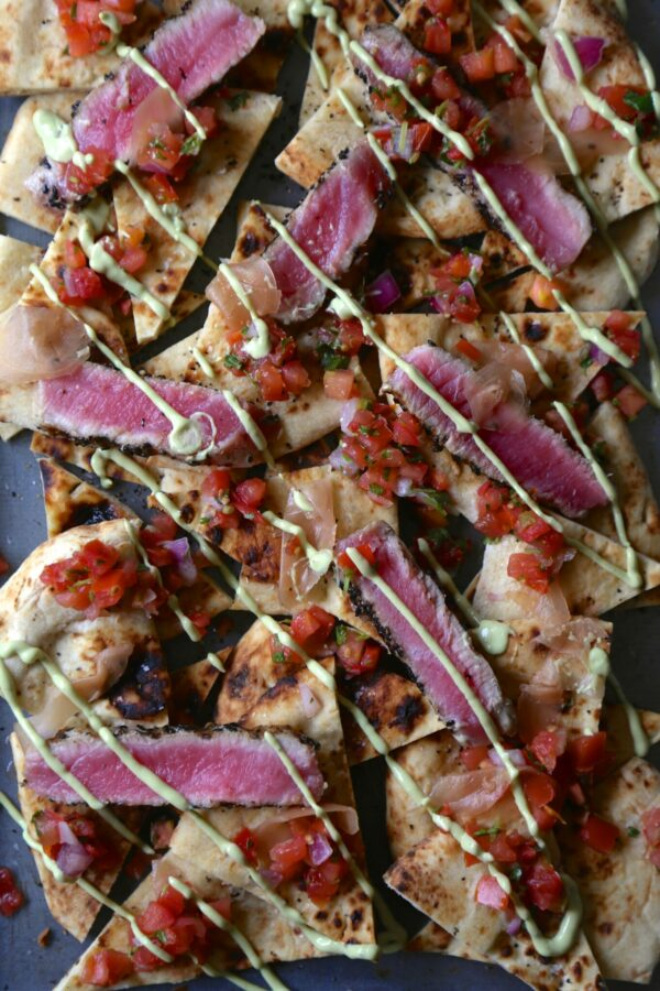 seared sesame ahi tuna naan nachos with avocado wasabi cream & pickled ginger www.climbinggriermountain.com