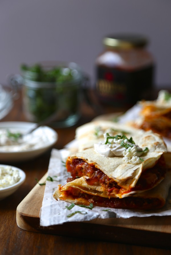 Spicy Harissa Quesadilla with Lamb, Caramelized Onions, and Cojita-Feta Cheese three