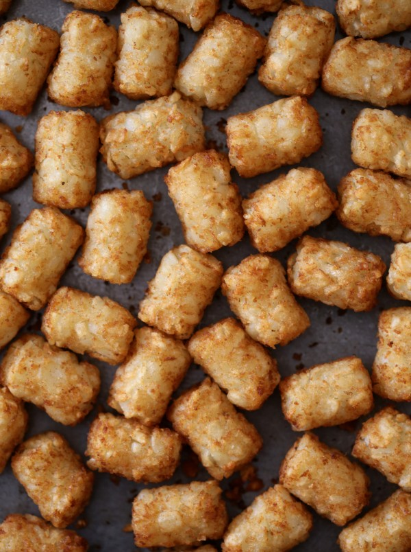 asian barbecue sticky tater tots with toasted sesame seeds