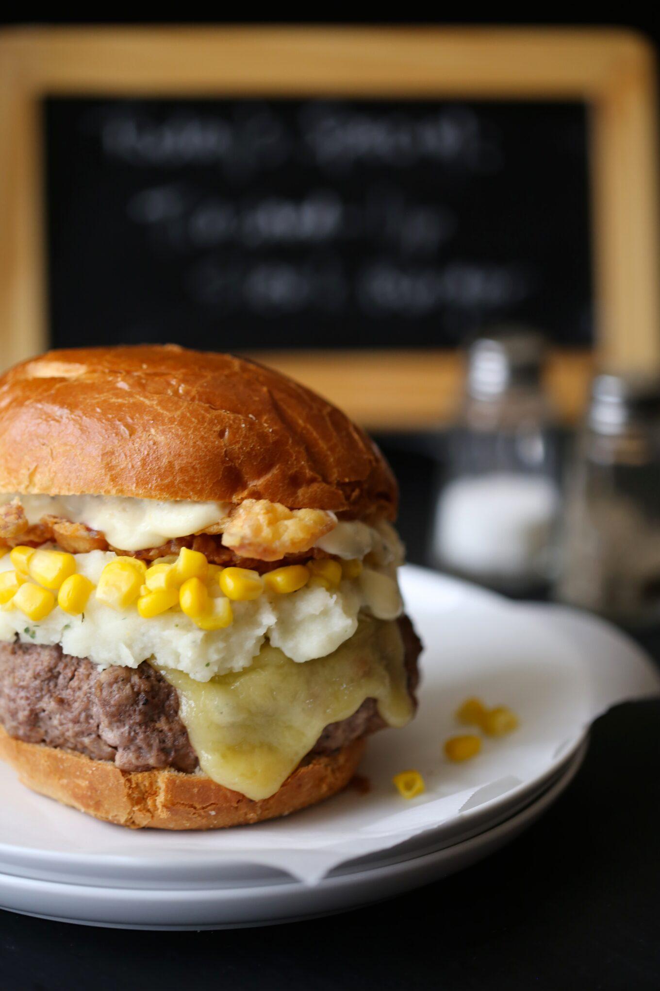 trashed-up steak burger with chicken fried bacon  u0026 dijon gravy
