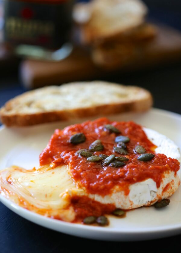 baked brie with harissa & moroccan spiced pepitas