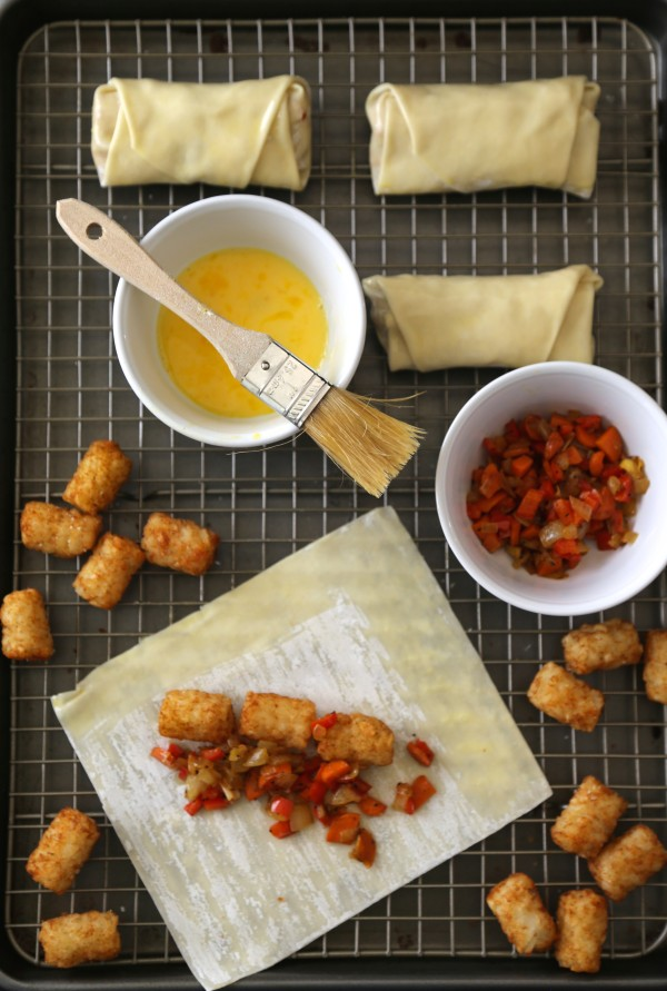 curried tater tot stuffed egg rolls with coconut dipping sauce