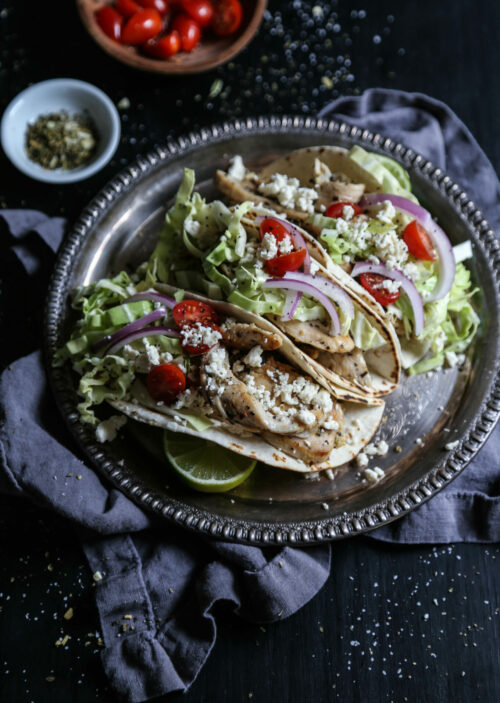 greek chicken tacos on a plate