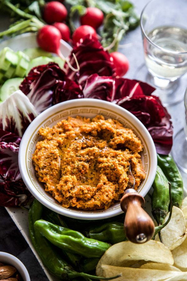 carrot dip in bowl with assorted food