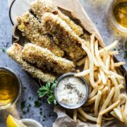 Baked Za'atar Fish Sticks and Chips on a table