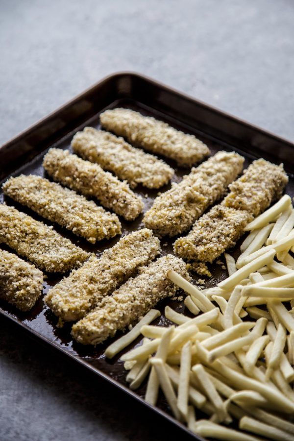 Baked Za'atar Fish Sticks and Chips on a sheet pan ready to baked