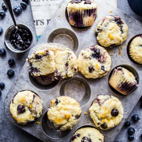 double blueberry citrus topped muffins on a table