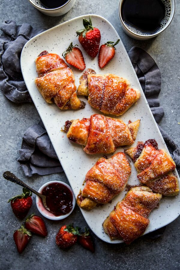 Easy Strawberry and Cardamom Croissants on a serving platter