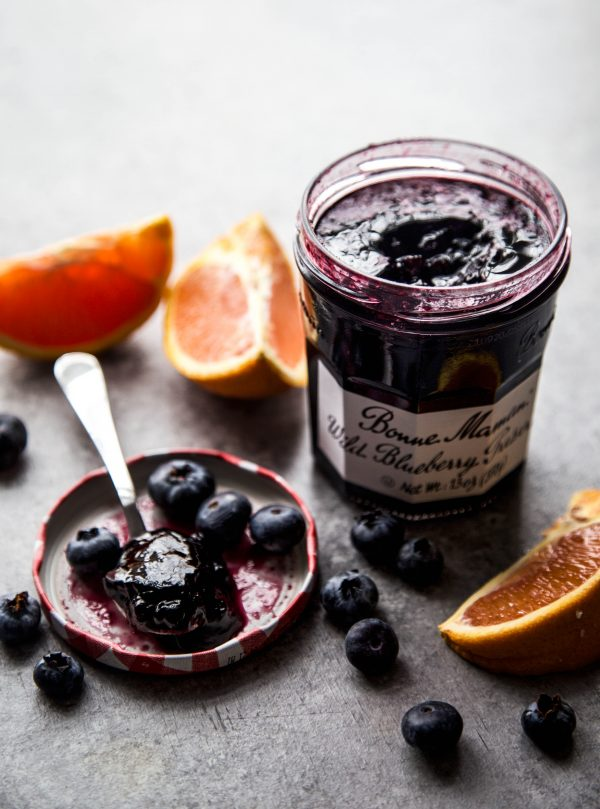 blueberry preserve and oranges on a table