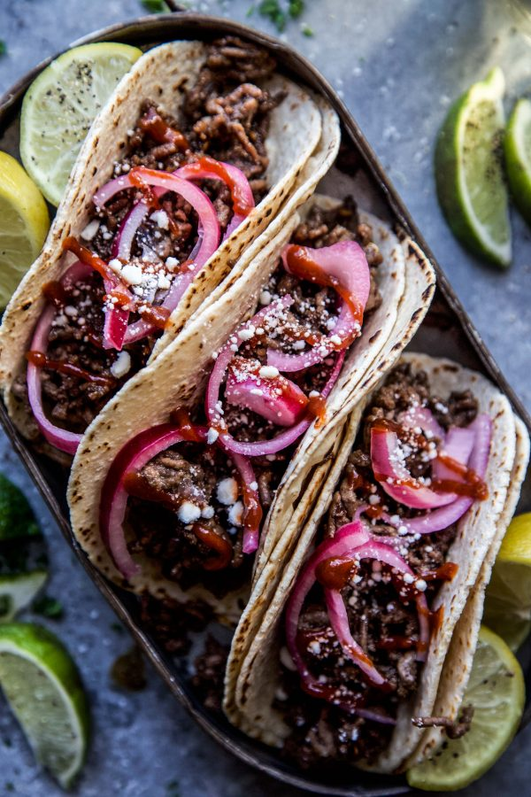 Sesame Beef Tacos with Quick Pickled Onions on a plate