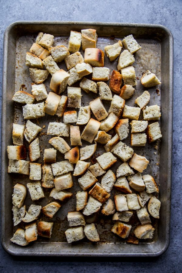roasted baguette cubes on a baking sheet