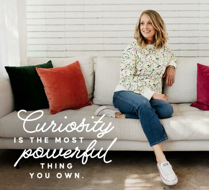 Lauren on a couch with text overlay: Curiosity is the most powerful thing you own.