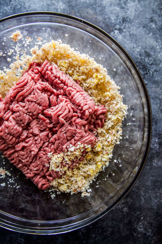ground beef with ingredients in a mixing bowl